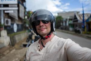 Selfie of man wearing helmet photo