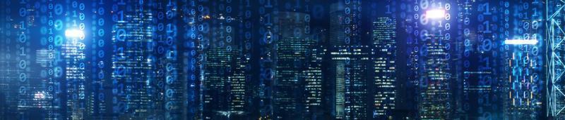 Binary computer code virtual city skyline photo