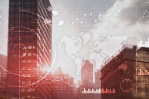 Trading control panel on virtual screen modern city background photo