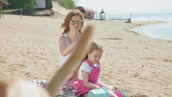 Mama is brushing her daughter outdoors summer video