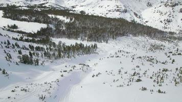 Aerial landscape nature in the winter snow covered mountains. video