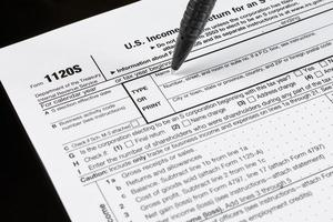 Form 1120S U.S. Income Tax Return for an S Corporation. United States Tax forms. American blank tax forms. Tax time. photo