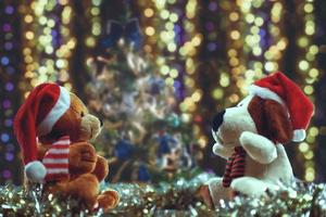 Two teddy bears enjoying Christmas and New Year Eve, New Year celebration concept. photo