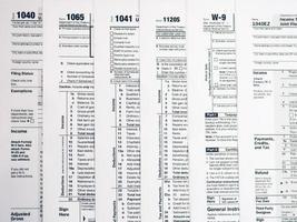 Form 1040 Individual Income Tax return form. Form 1041 U.S. Income Tax Return for Estates and Trusts. Form 1065 U.S. Return of Partnership Income. Form 1120 U.S. Corporation Income Tax Return.  American blank tax forms. Tax time. photo