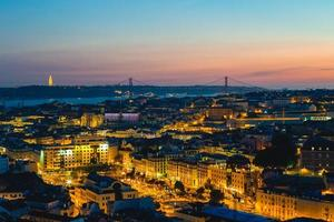 Lisbon at night, the capital of Portugal by river Tagus photo