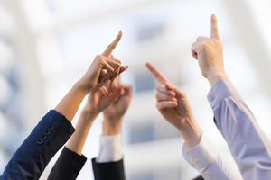 Different business people group raising hands photo