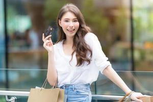 Black Friday concept, Woman holding many shopping bags with credit card and smiling photo