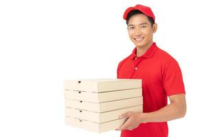 Delivery man employee in red t-shirt uniform face mask holding empty cardboard box photo