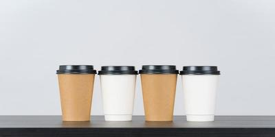 Blank paper coffee cup set on white background photo