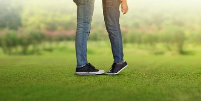 Couple kissing, girls stands on tiptoe to kiss her man photo