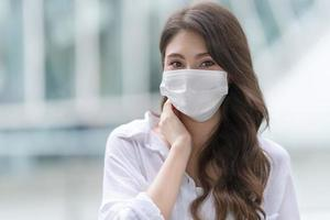 Young woman wearing medical face mask photo