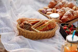 picnic in the nature, fresh pastries, croissants. French croissants photo