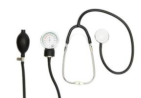 Medical Concept with stethoscope, blood pressure gauge isolated on white. Copy Space. Close up view photo