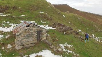 Aerial view of a trail runner and a small house. video