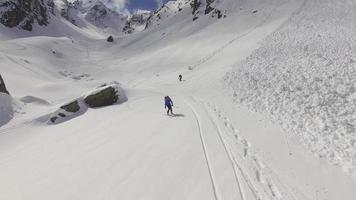 Aerial view of skiers on snow covered mountains. video