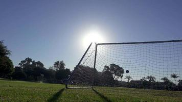 Morning at a park with a soccer football game about to begin on the grass field. video