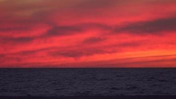 The sun sets over the beach at sunset. video