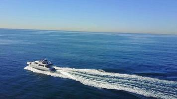 Aerial drone uav view of a motor boat and the ocean. video