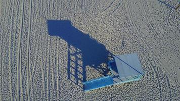 Aerial drone uav view of a lifeguard tower at the beach. video