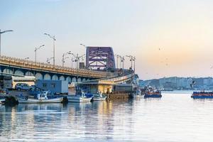 Seoul, Korea, Jan 02, 2016 - Bridge over a river in a fishing village photo