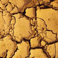 Dried cracked mud suitable as background and climate change symbol photo