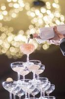 Rows of champagne glasses in wedding party photo