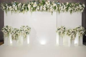 Wedding backdrop with flower and wedding decoration photo