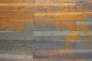 Detail of an aged wood parquet floor before repair photo