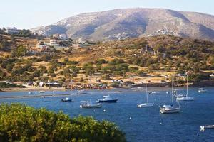 Scenic view of sea bay with boats and beach in background, Anavyssos, Greece photo