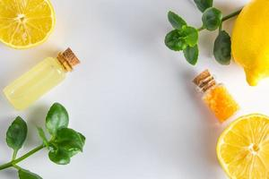Spa cosmetics with citrus on a white background. Eco product for alternative medicine with lemon. photo