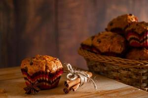 Homemade muffins with raisins. Christmas baking on a wooden background. photo