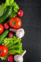 Fresh vegetables on a dark background. The concept of healthy nutrition and diet. photo