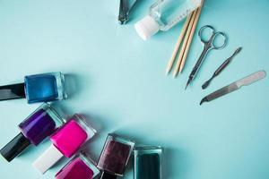 Set of tools for manicure and nail care on blue background. Spa hand procedure, place for text. photo