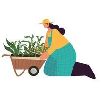 agricultora con carretilla y plantas vector