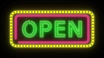 letrero de neón con la palabra parpadeo abierto use marco de luz rosa y amarillo video