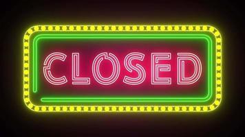 letrero de neón con la palabra parpadeo cerrado use marco de luz verde y amarillo video
