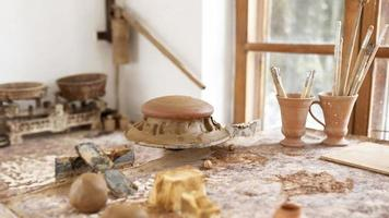 pottery workplace with different creations table photo
