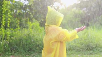 Asian child playing in the rain video
