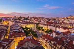 Skyline of Lisbon at dusk in Portugal photo
