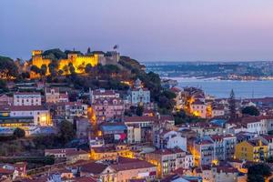 Night view of Lisbon and Saint George castle, Portugal photo
