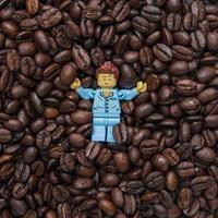 Warsaw 2020 - Lego minifigure sleeping in the coffee seeds photo