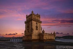belem tower in belem district of lisbon in portugal at dusk photo
