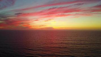 Aerial drone view of a sunset at the beach over the ocean. video