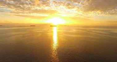 Aerial drone view of a scenic tropical island in the Maldives at sunset. video