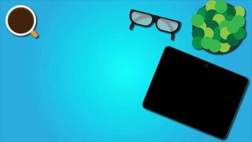 Top view of worktable with goggle, coffee, flower pot and tablets. Blue Background. video