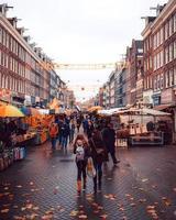 Amsterdam, Netherlands 2018- People walking in a street market in Amsterdam photo