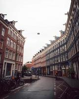 Amsterdam, Netherlands 2018- A row of houses on a street in Amsterdam photo