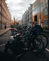 Amsterdam, Netherlands 2018- A row of bicycles parked in the street in Amsterdam photo