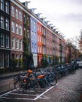 Amsterdam, Netherlands 2018- Bicycles in front of colorful houses in Amsterdam photo