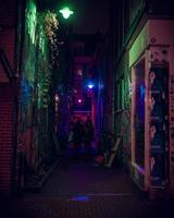 Amsterdam, Netherlands 2018- Colorful alleyway lit up with lights at night in Amsterdam photo